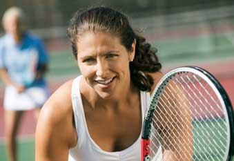 Woman playing tennis after acupunture